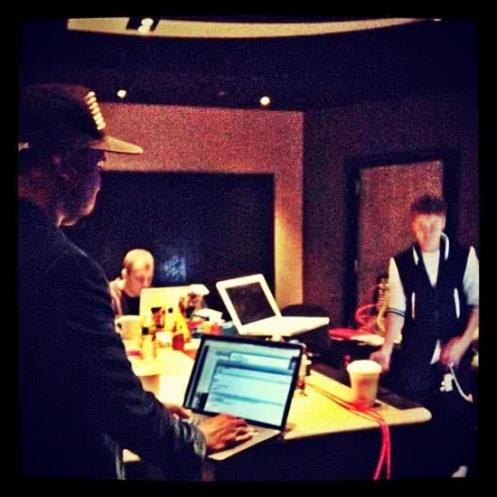 "Studio Pic: @justinbieber and @kanyewest working on a track for the forthcoming album,  #Believe""."